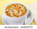 Chicken noodle soup with carrots and celery in a white bowl - stock photo