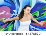 Girl against grafitti wall - stock photo