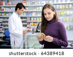 Customer buying medicine at the pharmacy - stock photo