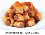 Sausage rolls on the white plate - stock photo