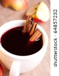 Glass of hot wine with cinnamon sticks - stock photo