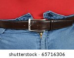 Fat man in very tight jeans - stock photo