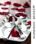 place setting for valentines day with petals - stock photo