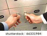 unlocking deposit safe - stock photo