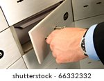 businessman unlocking safe - stock photo