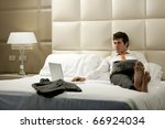 Relaxed Businessman reading newspaper - stock photo