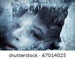 Face in ice, in blue tones - stock photo