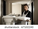 Maid with housekeeping cart - stock photo
