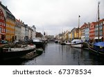 Nyhavn in Copenhagen, Denmark - one of the most popular tourist places of the capital. - stock photo