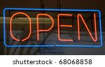 Red and blue lit neon sign at local donut shop - stock photo