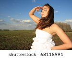 Young woman looks afar - stock photo