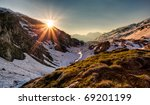 Sunrise in a swiss alps valley - stock photo