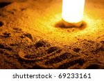 The inscription on the sand illuminated by a flashlight - stock photo
