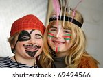 Kids dressed as little pirate and indian girl - stock photo