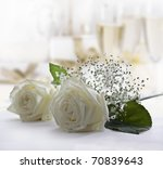 White roses and champagne - stock photo