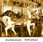 carousel horse ride done in sepia - stock photo