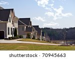 A row of modern houses in a suburban neighborhood. - stock photo