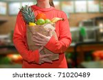 healthy woman. holding a shopping bag full of fruits. isolated - stock photo