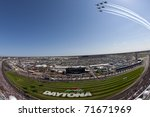 DAYTONA BEACH, FL - FEB 20:  The NASCAR Sprint Cup Series teams take to the track for the Daytona 500 race on Feb 20, 2011 at the Daytona International Speedway in Daytona Beach, FL. - stock photo
