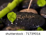 The leaves on the stones and incense - stock photo