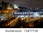 Central Edinburgh from Regent Road at night - vista including Waverley Train Station, North Bridge, Bank of Scotland building and Edinburgh Castle - stock photo