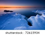 Before sunrise in icy beach - stock photo