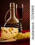 Red wine glass and cheese - stock photo