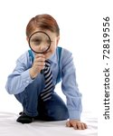 Boy with a magnifier - stock photo