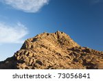 Rugged mountain against a blue sky. South Sinai desert, Egypt. - stock photo