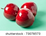 Red sweet apples on a green background - stock photo