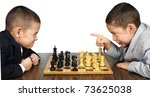 boys playing chess game, one is upset over a move by the other - stock photo