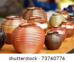 Glazed ceramics are for sale at an outdoor market - stock photo