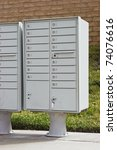 Group of mailboxes are in an arrangement in a residential neighborhood. - stock photo