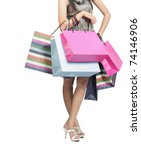 Beautiful stylish woman holding shopping bags in both hands - stock photo