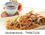 Chinese fried noodles with hot tea - stock photo