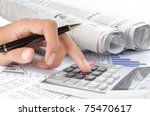woman's hands with a calculator and a pen. newspaper on a background - stock photo
