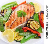 grilled salmon with vegetables on white plate - stock photo