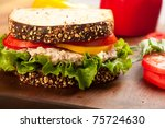 Tuna fish sandwich on multigrain bread with lettuce and tomato - stock photo