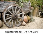 old wooden cart with clay pots on gravel base, gardening idea - stock photo