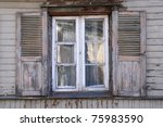 Window of a old wooden house - stock photo