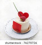 Souffle with raspberry and heart on the top - stock photo