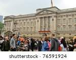 LONDON, ENGLAND - APRIL 29: Spectators in front of the Buckingham Palace on April 29, 2011 in London, England. - stock photo