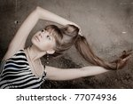 young beautiful girl plays with the long hair - stock photo