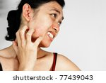 Young woman scratching her face having allergy skin problem - stock photo