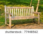 A bench in a spring park: morning scene - stock photo