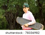 Young girl with well used scateboard - stock photo