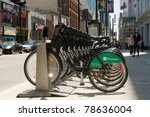 TORONTO, CANADA - JUN 5: Bixi bikes stand on Yonge St in Toronto, June 5, 2011.  Bixi bikes is a public bike sharing system launched in Montreal in 2009 and is now spreading other cities of the world. - stock photo