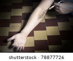 Hand of drug user in the dark interior with opium syrigne - stock photo