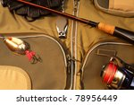 Fishing rod, hooks and reel with fishing line - stock photo