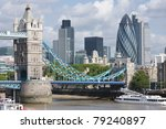 A view of Tower Bridge and the Gherkin from across the Thames - stock photo